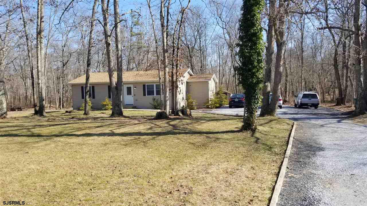 Desirable location on 1.9 acres set back off the road for privacy. Updated ranch home with 2 full ba