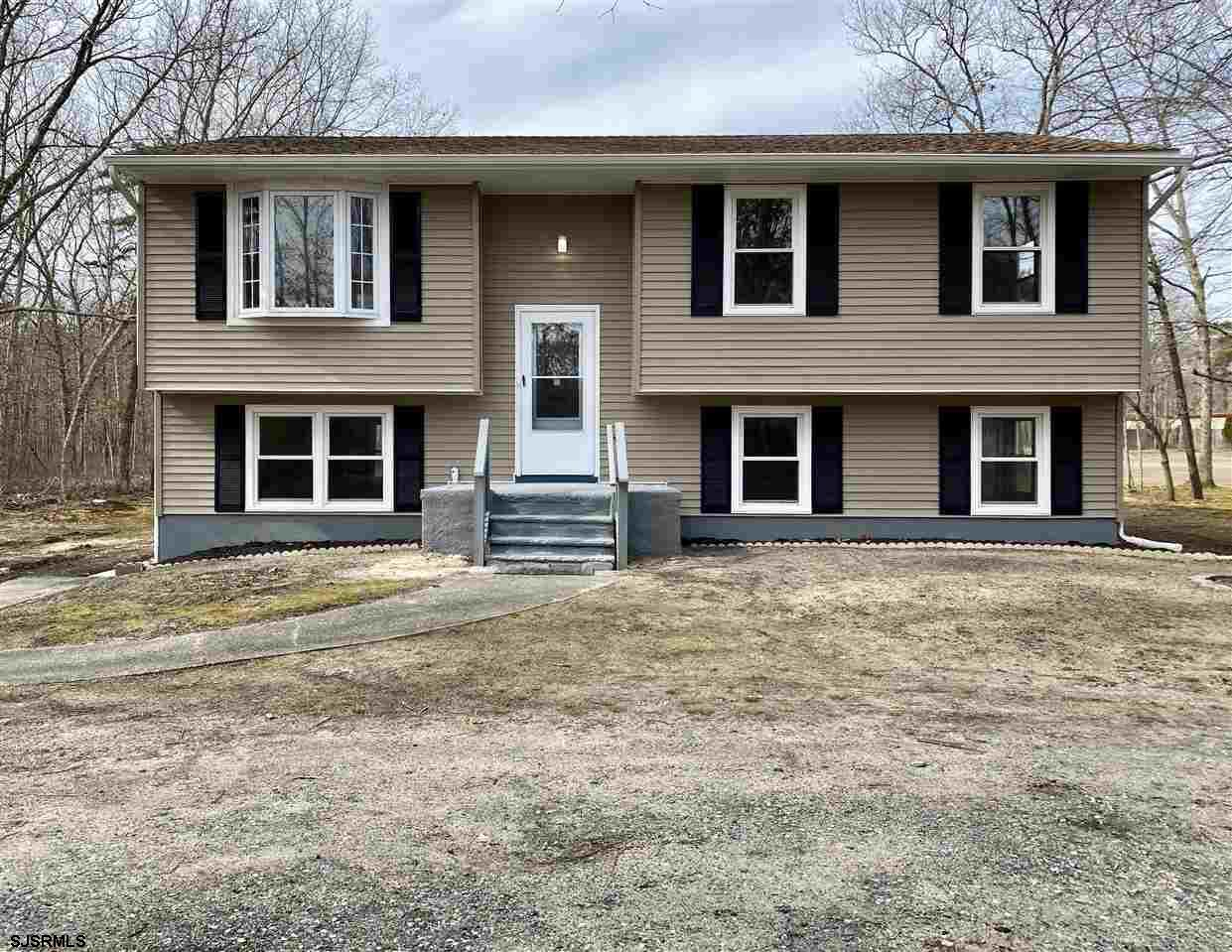 Beautiful split level home in a great location! Laminate wood floors extend across the open concept