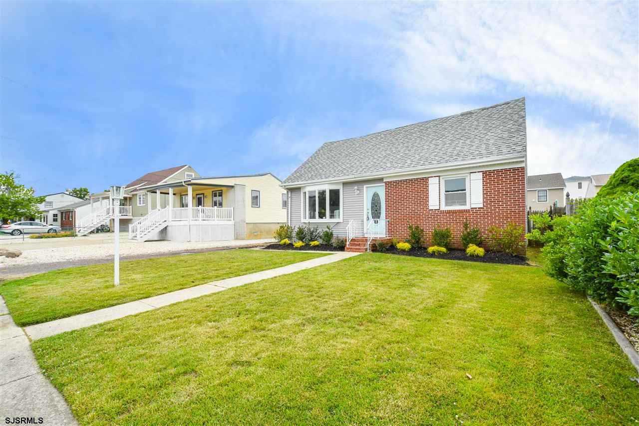 STUNNING RENOVATION on this beautiful Cape Cod in a fantastic location! Short walk to the beach, bay