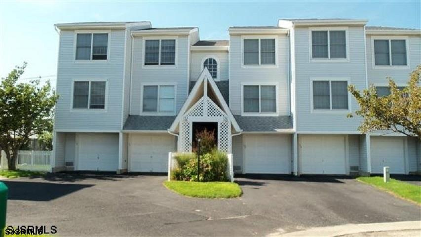Move right in this turn-key renovated top- floor 2 BR, 2BA, BAYBERRY condo situated in a cul -de -sa