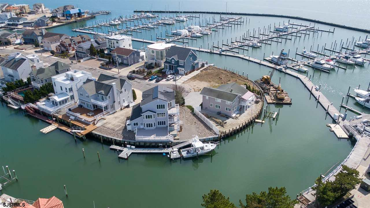Location, Location, Location!  With over 131 feet of waterfront, this 4BD/3BA, Seaview Harbor home g