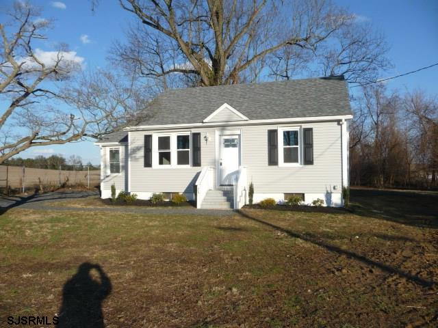Upgraded bungalow with 2 bedrooms on 1st floor and large finished room on 2nd floor. New kitchen cabinets and appliances, beautiful counter top, freshly painted, new bath, sunroom, large unfin basement and 2 car detached garage. Desirable  peaceful location in Hopewell Twsp.
