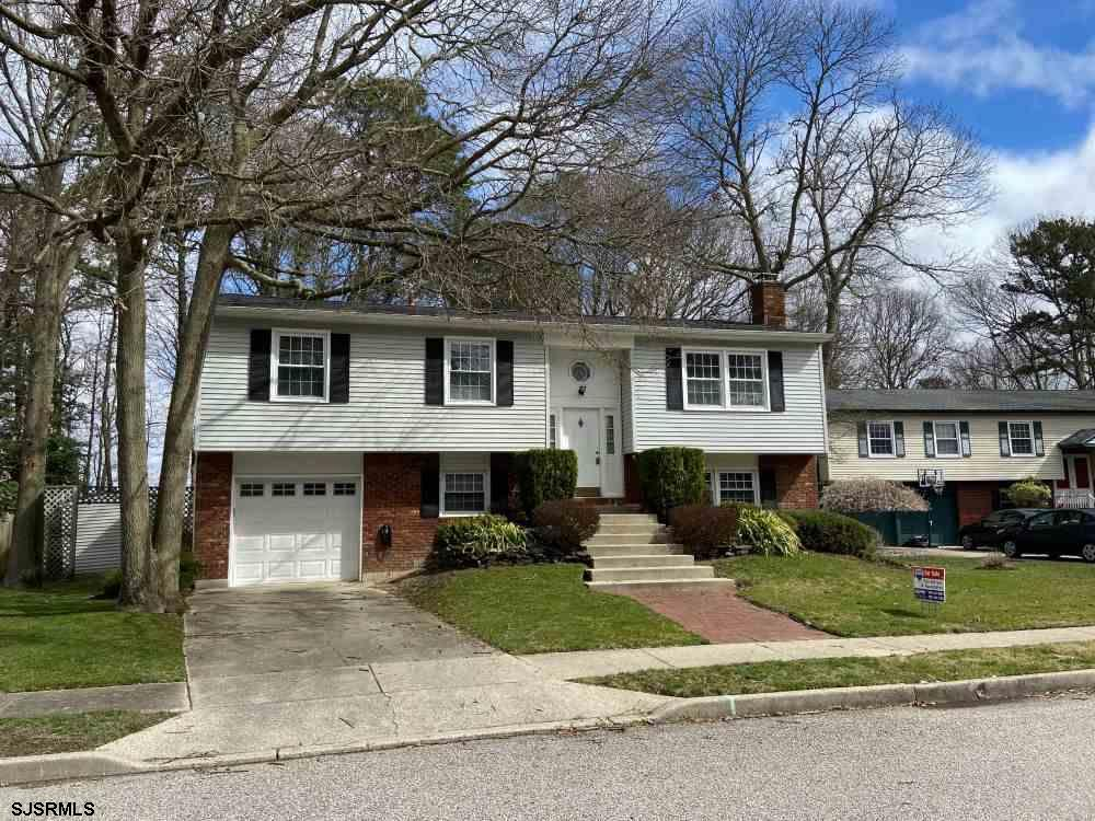 Single Family Split level home located right on Patcong creek with beautiful water views.   Home fea