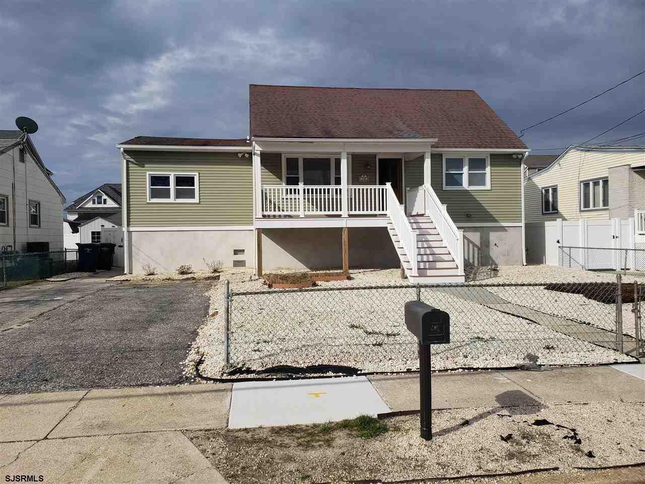 A great opportunity to own a raised rancher on the island with off street parking and a large front