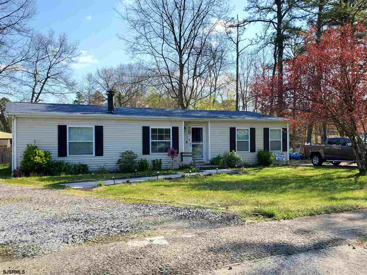 Adorable 3 bedroom 2 bath ranch in desirable Mullica Township, near recreation park and school.Totally updated , this home has newer flooring, kitchen, heat and air and features a wood burning fireplace in the great room! This home sits on a large corner lot, and has a huge deck for entertaining. Also included is a 28 x 12 storage shed. Schools are highly rated Cedar Creek and Mullica Township elementary.