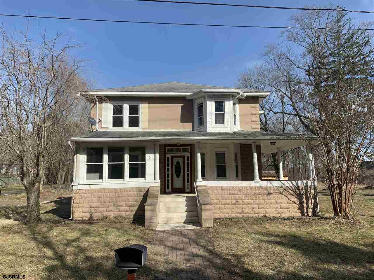 Beautiful home with covered front porch, updated Eat-in kitchen, dining room, family room, nice bedrooms sizes, hardwood floors. Wood staircase, charming features! Situated on nice lot with yard. Being sold AS-IS!