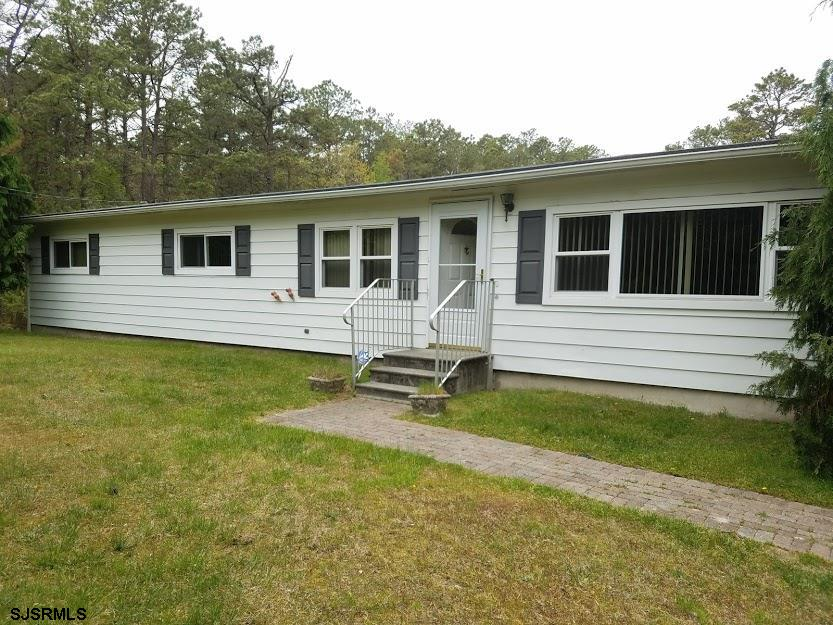 3 bedroom 2 bath 1776 sq feet rancher on 20 acres!!!  Could possibly be 4 bedrooms and could easily