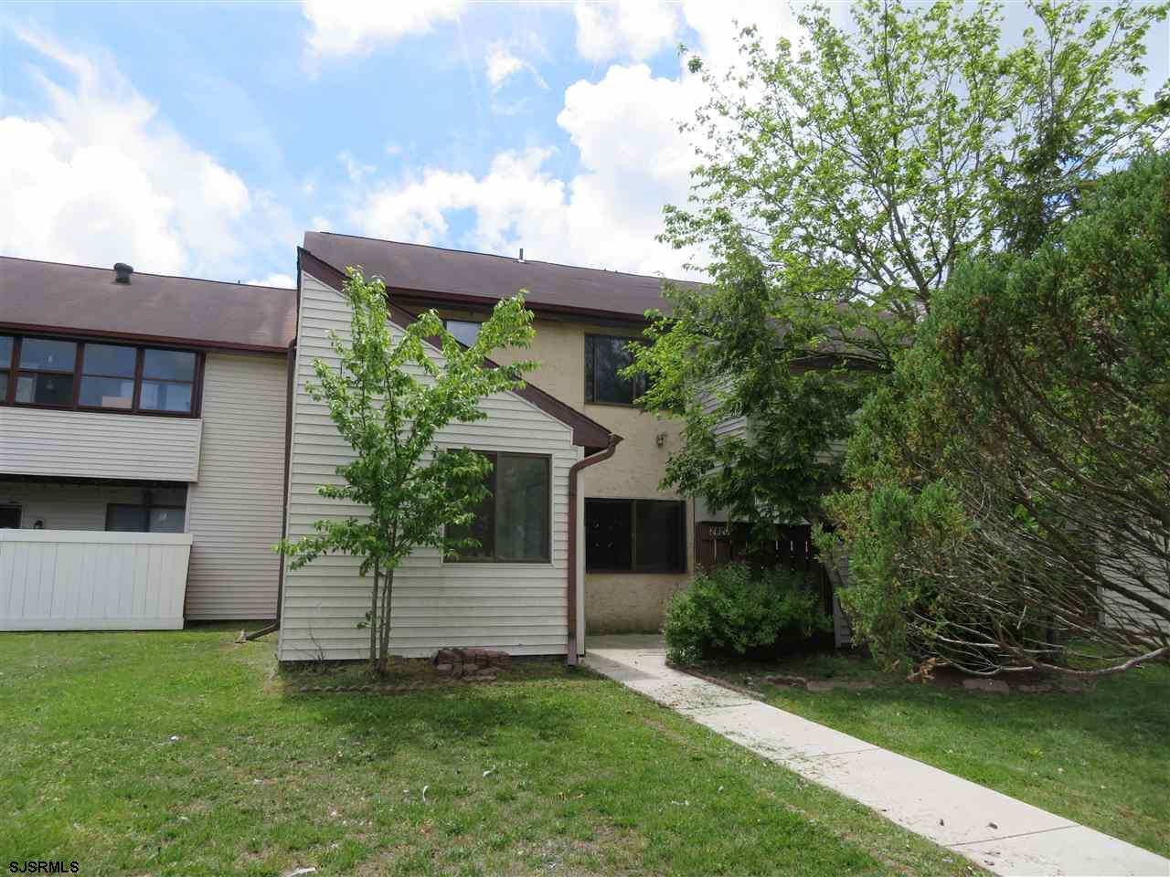Spacious 2-story unit with 2 bedrooms, 1.5 baths and a den.  Private entrance with patio and storage