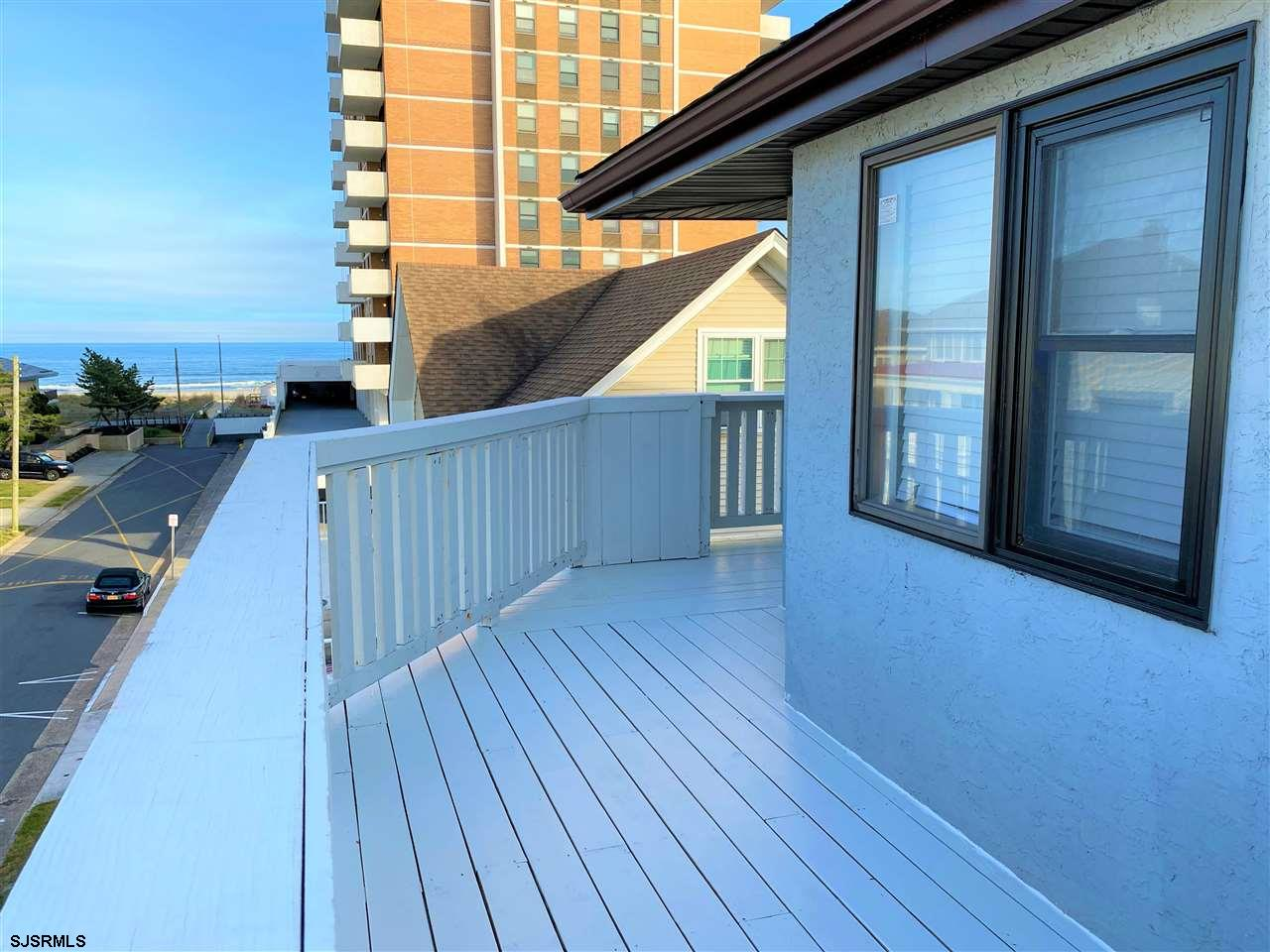 Elevate Your Expectations with this BEACH BLOCK Completely Renovated Down to the Studs, Top Floor Pr