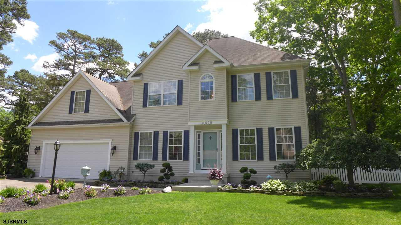 Have it all with this 4 bedroom 2.5 bath home in the Lake Lenape community. Great for entertaining w