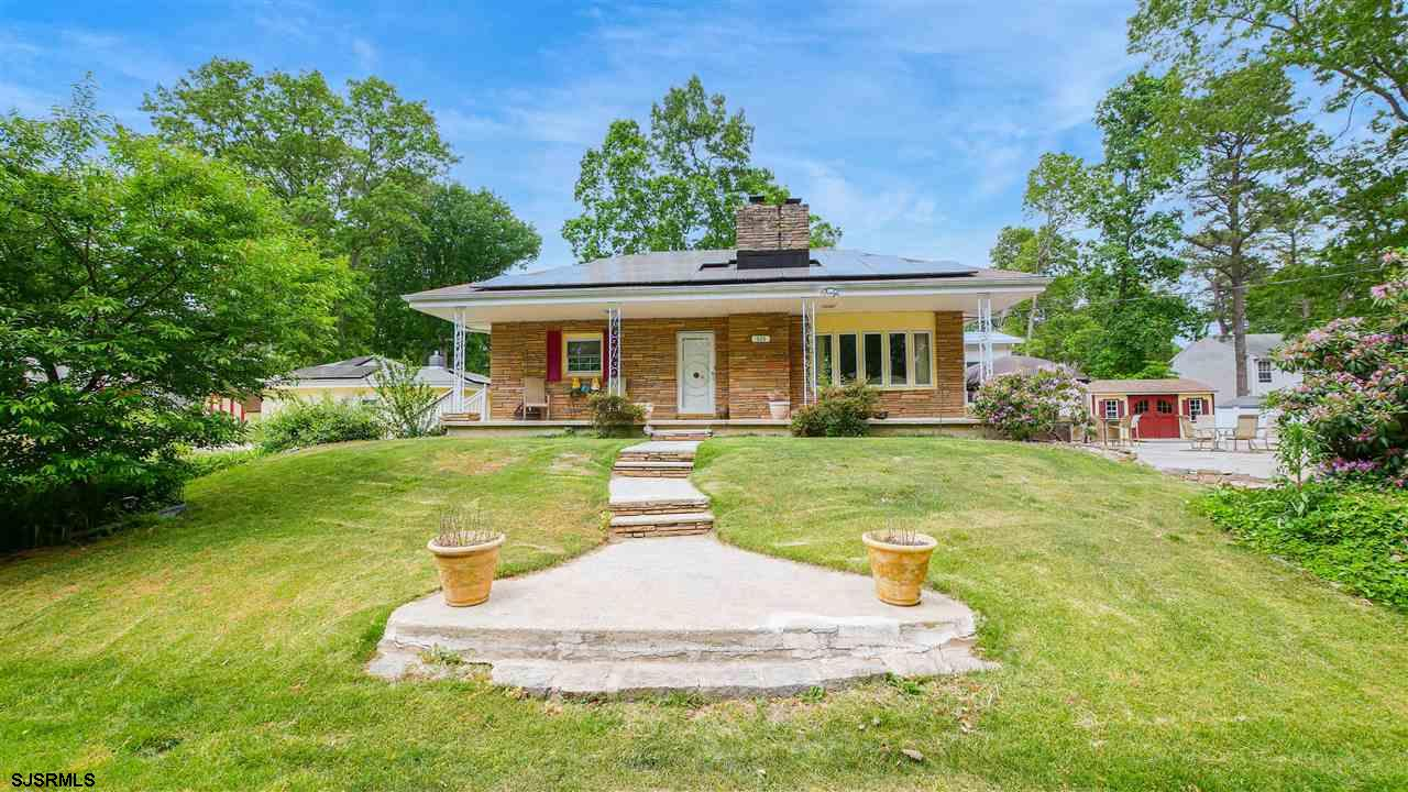 Two homes for the price of one! Main home has 3 bedrooms, 1.5 baths and features a stone fireplace,