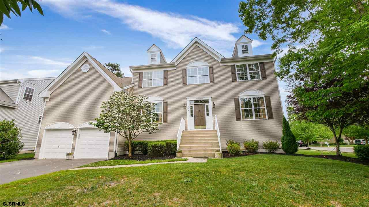 Immaculate home in Kensington Village of Smithville. The Charleston which is the largest at 3343 sq.