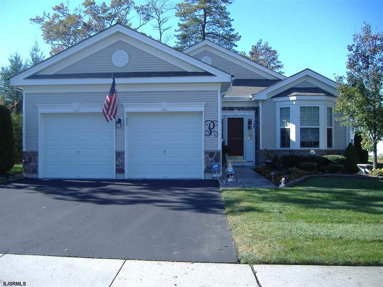 Stunning stone front Juniper model situated on large wooded lot.  Granite counter tops, SS appliance