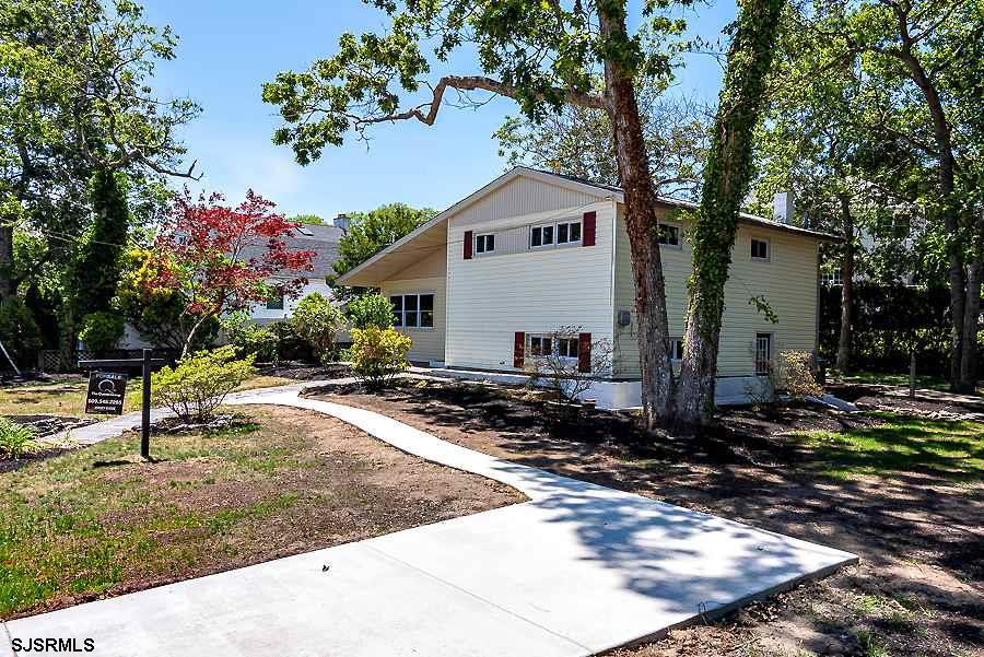 Completely re-designed and upgraded better then new construction, 4 bedrooms 2 bath home set back on