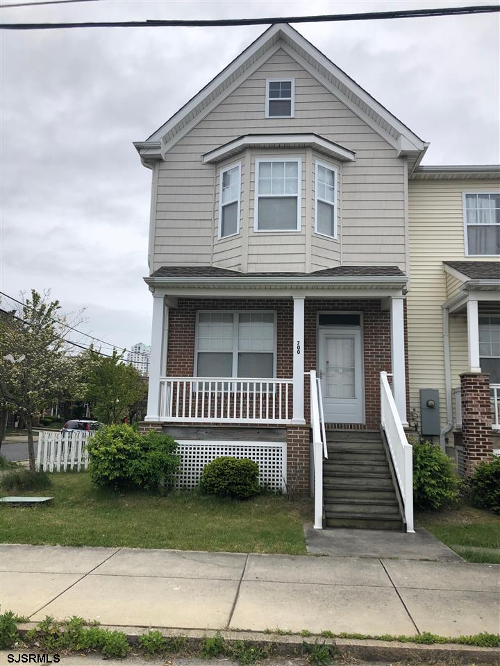 Large corner lot with fenced in yard and off street parking in the rear of the property. Very clean