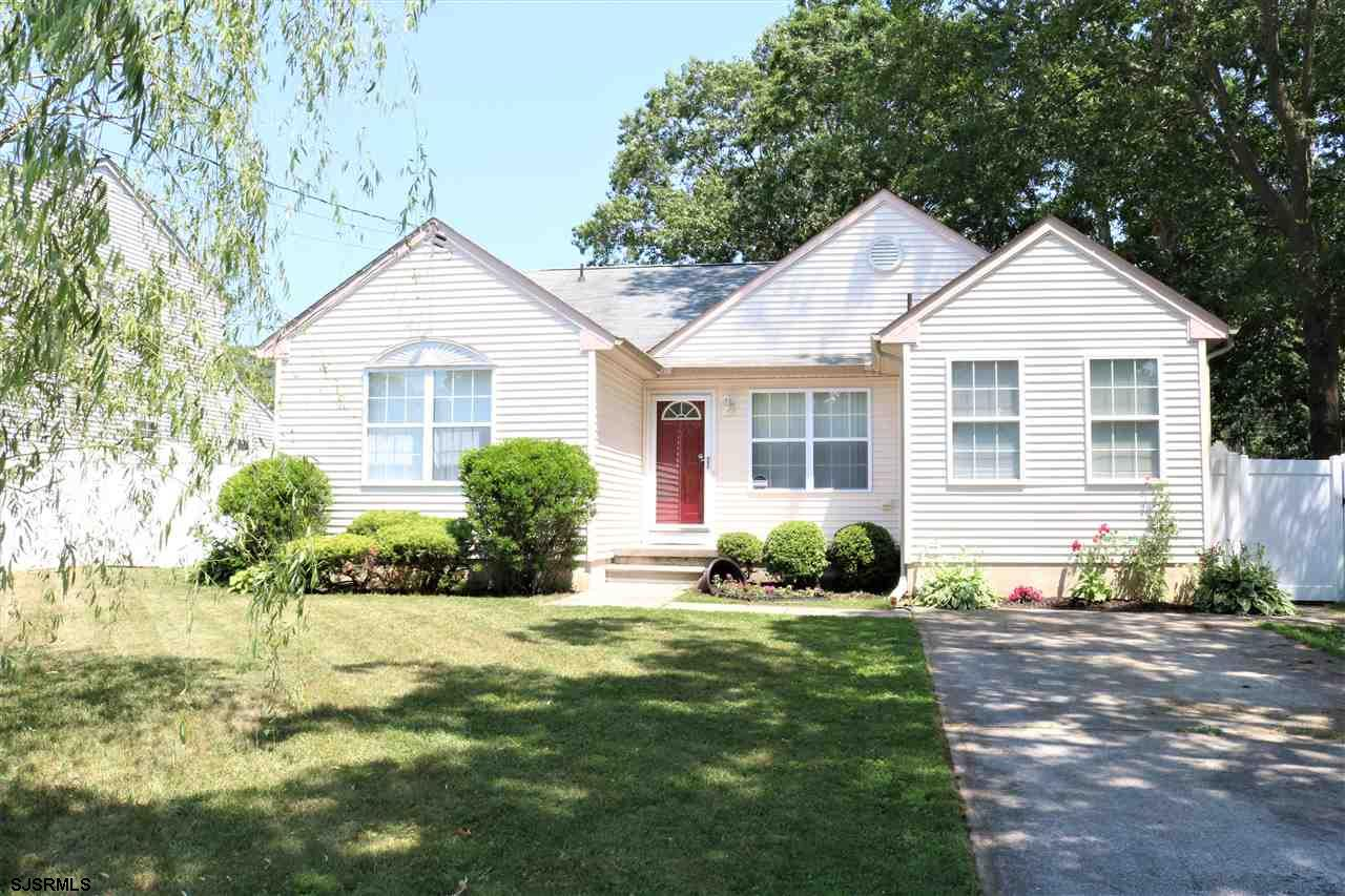 Sun light and charming describes this move in ready rancher! Well maintained 3BR 2 BA with wide plank Brazilian cherry hardwoods, cathedral ceiling family room and split bedroom layout. Master suite with spacious walk-in closet! Eat in kitchen and dining area. Enjoy the back paver patio and fenced yard for outside entertaining. Located close to Stockton College, shopping,  and parkway access. 2 storage sheds