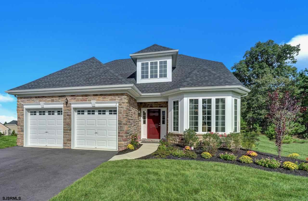 Lovely new construction Rhapsody floor plan at fabulous Woods Landing on premium lot location at the