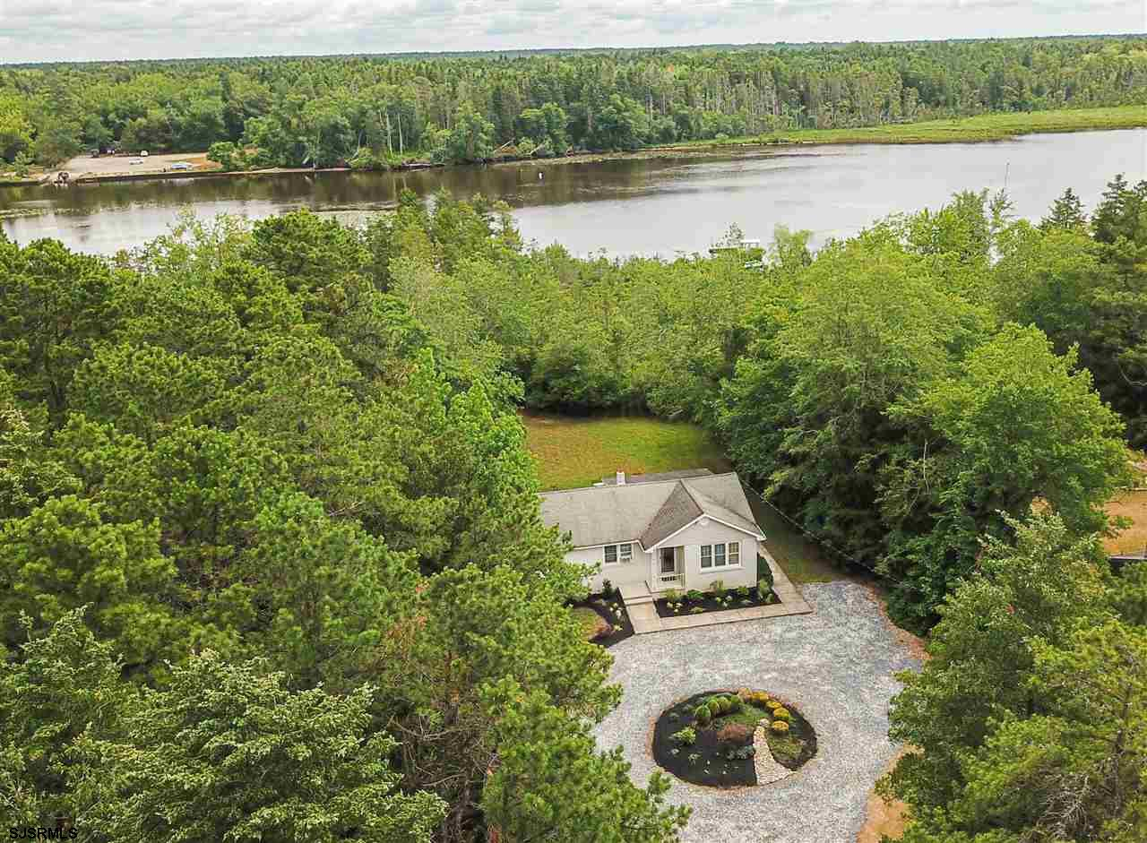 RIVER FRONT on 2.5 ACRES!!! Escape to the Mullica River in this adorable ranch home that not only of