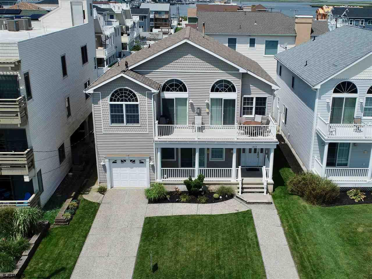 OCEAN FRONT LIVING! LOCATION, LOCATION! This like-new, two- level, 4 BDRM; 3.5 BA; beautiful CONTEMP