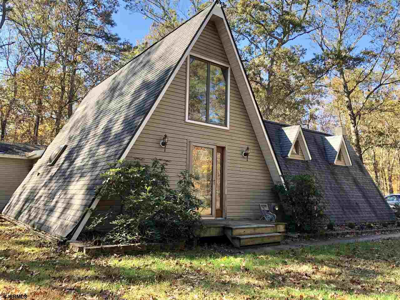THIS HOME IS ANYTHING BUT TRADITIONAL! Super unique A-Frame multi-level home with so much character, space and just a bit out of the ordinary. If you've grown tired of cookie cutter floor plans and want something different then you need to check this one out!  The first floor offers 2 bedrooms including the newer master suite plus a guest room and hall bath.  The laundry center is also housed in this area.  The galley style kitchen is so rustic and cute and is adjacent to the dining room.  From the living room, there are two small stairwells - one that takes you to the original master suite and a second one that leads you to an upper level loft which would make a fabulous office.  The open stairwell and the roof line does allow one to view