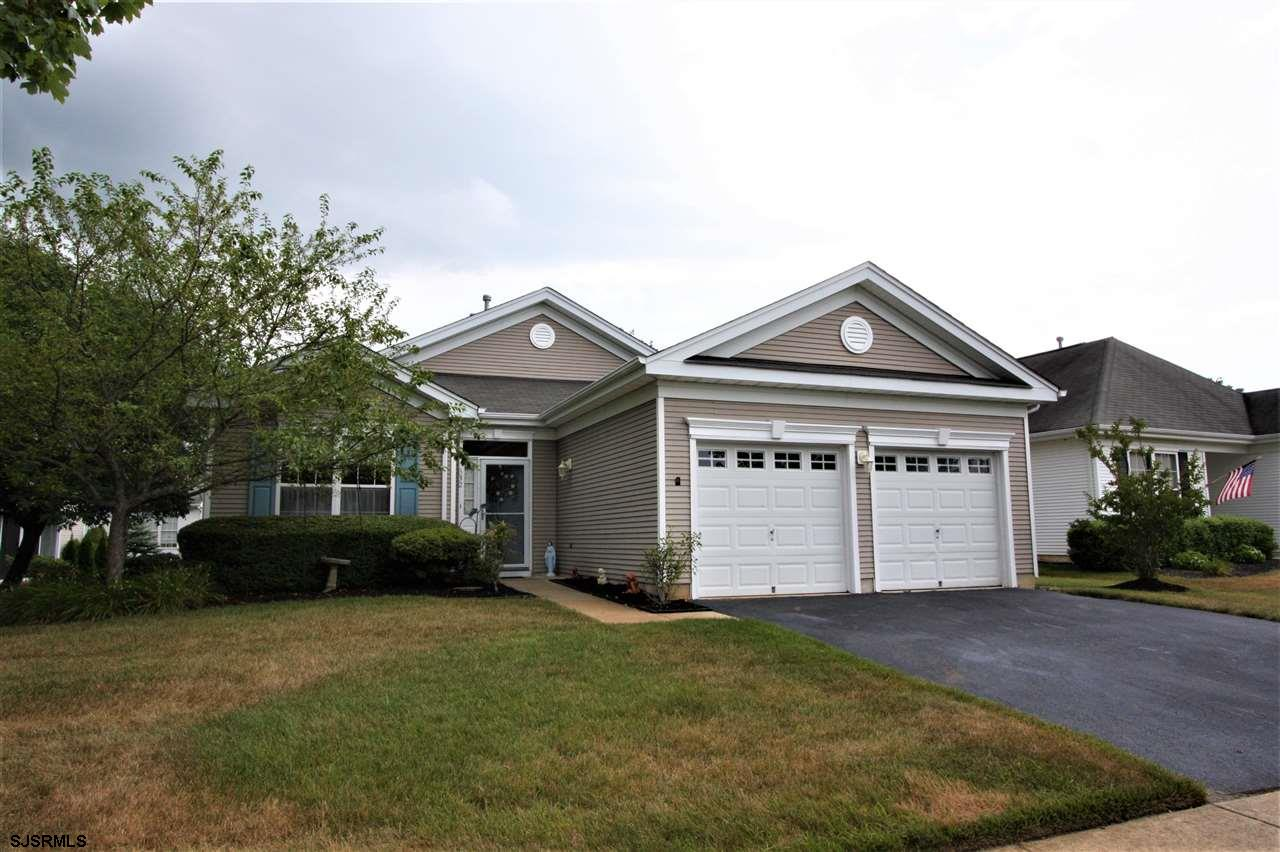 Beautiful and well maintained Juniper model with 2BR's/ 2 BA plus Den. This unique model has an open