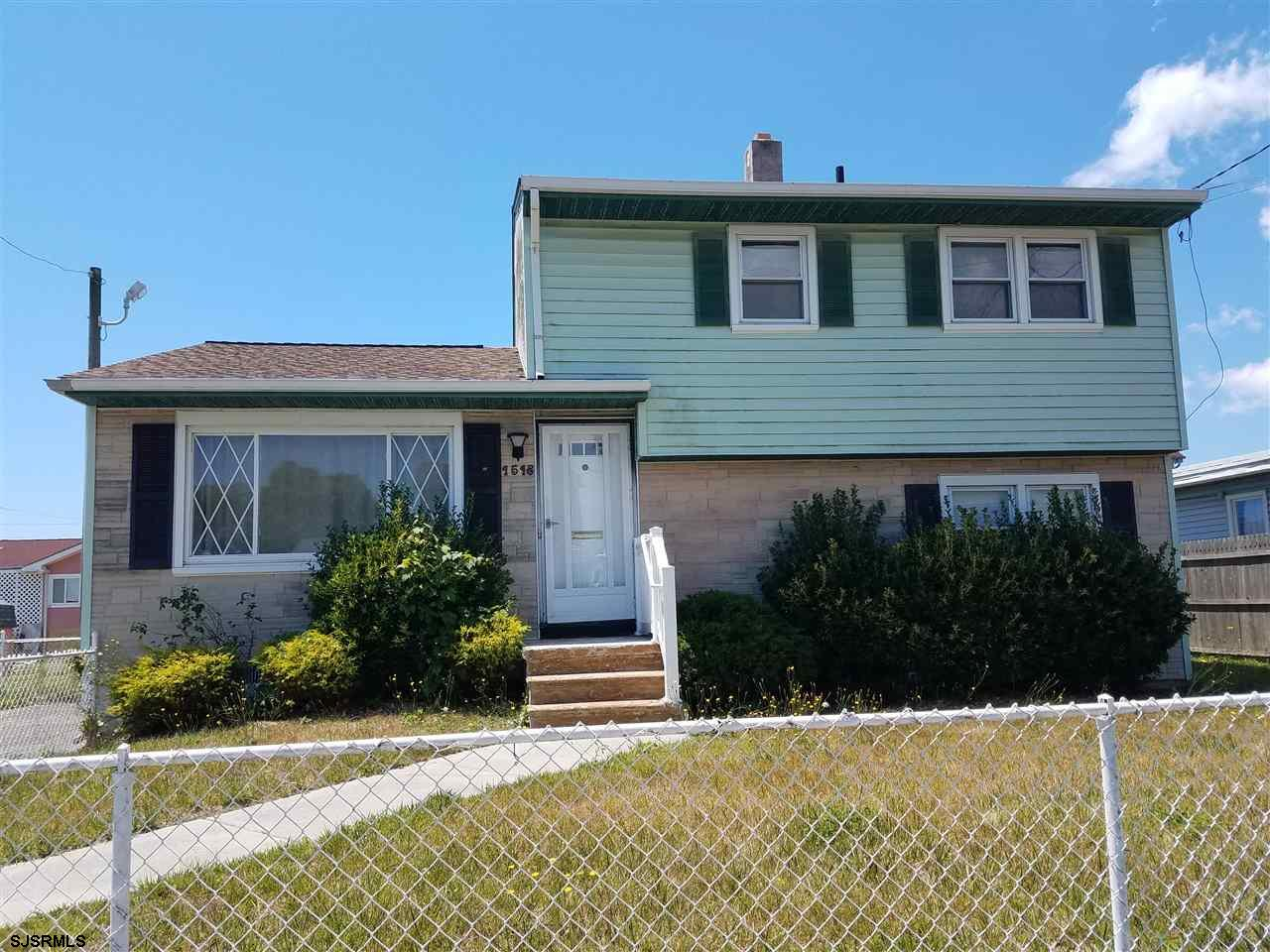 Totally Renovated 3 Bedrooms 1 and half bathroom possibly a 4th bedroom or a separate home office in