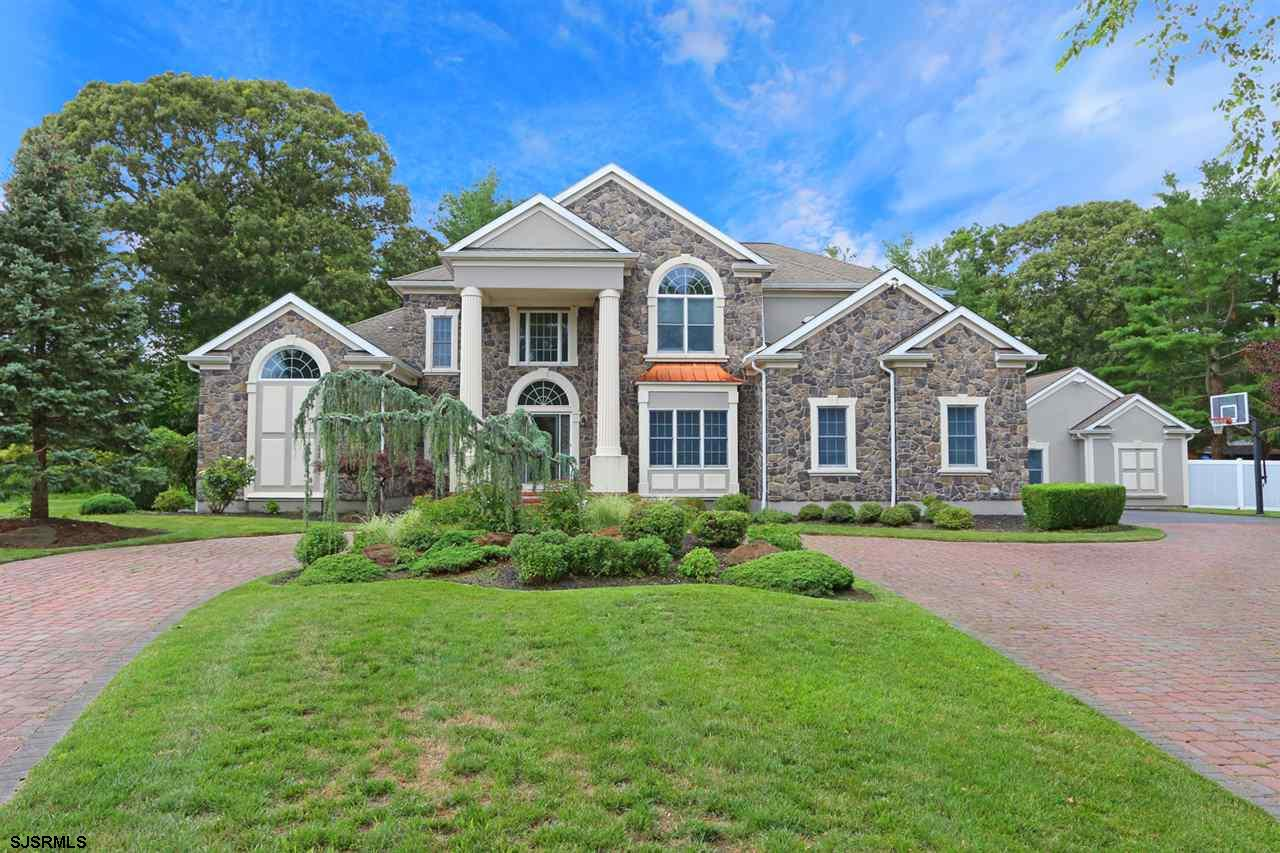 Stately Fischer Greene executive home with upgrades galore. From the moment you enter this home you are sure to be impressed. There is a large living room, dining room and family room which has a huge custom stone fireplace. The gourmet EIK overlooks the family room and has 42 inch cabinets, granite countertops, center island and top of the line SS appliances. There are a total of 5 BD's with the Master BD located on the 1st floor and an updated Master Bath, custom tile throughout and a large walk in closet. The 4 additional BD's are located on the 2nd floor and each have walk in closets. Three full baths upstairs (there is a jack-n-Jill bathroom). There is also a large loft which can be perfect for a game room!  There is a full finished ba
