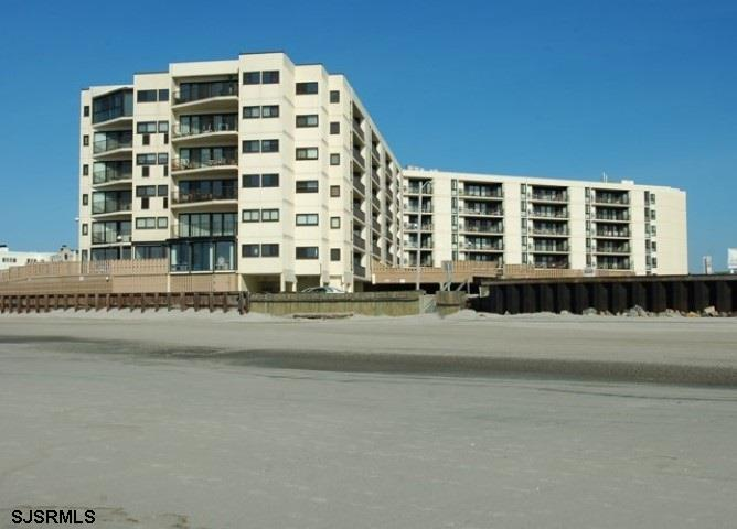 Do not miss this rare opportunity to make this southern exposure condo your home at the shore. Enjoy the sun-drenched balcony view of the ocean during the day, and the sounds of the waves at night. Hardwood and tile floors and throughout this spacious open floor plan. Large Master Suite boasts enough room for a King size bed and a pull-out couch. Full size washer and dryer in the unit.Easy parking in the assigned spot in the covered garage. Beautiful lobby, pool, sun deck and direct access to the beach.  Masks are required for all showings. Covid-19 waiver must be signed and returned prior to all showings.