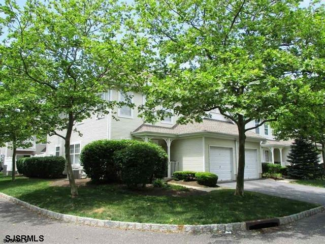 Love where you live!!! A must see this beautiful corner/end unit at The Cove on Anchorage court loca