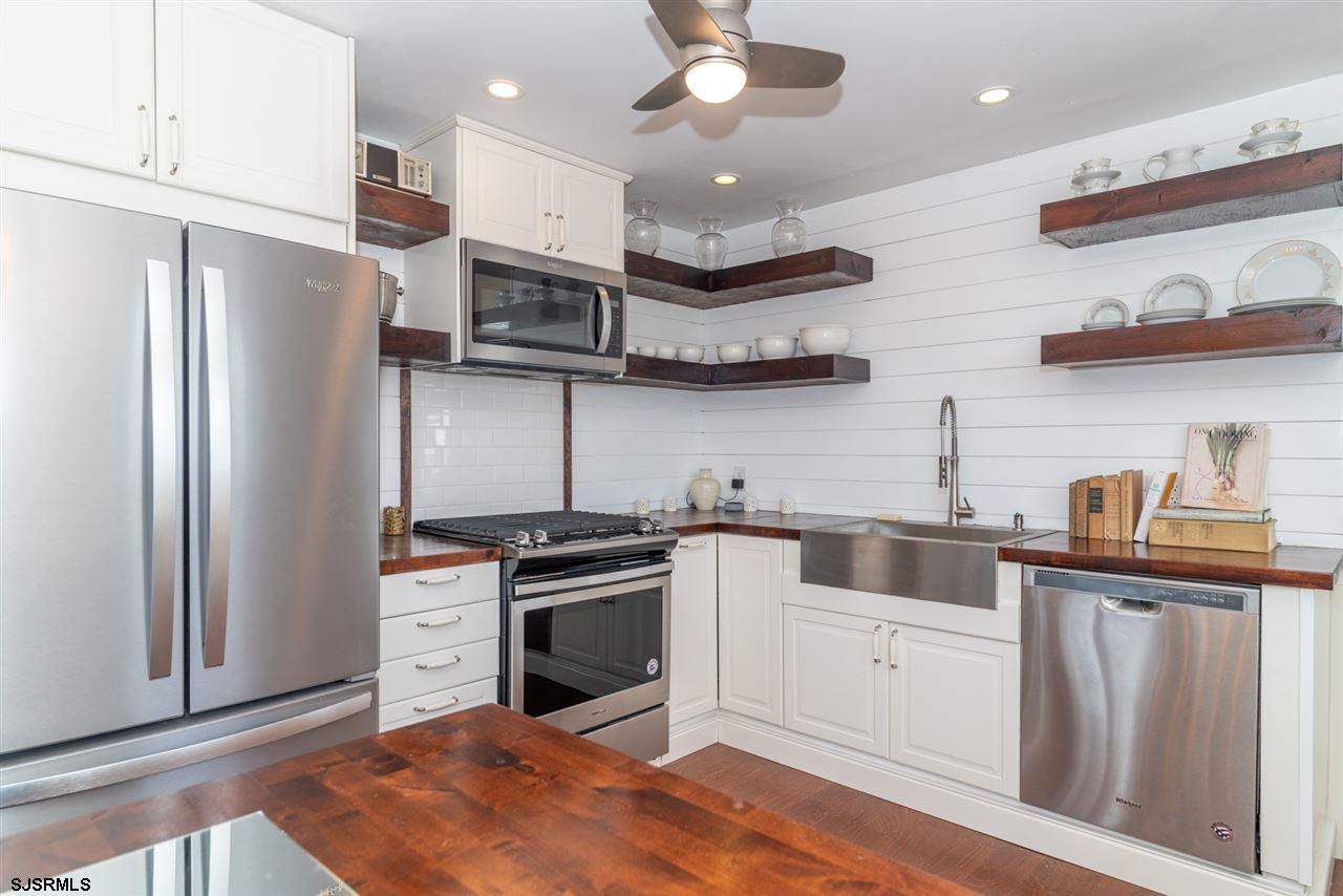 Exceptional Renovation! This turnkey 3 Br. 1.5 Ba. rancher is located within walking distance to the