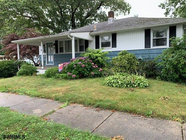 3 Bedroom 1 bath ranch filled with potential. Corner lot. Wall to wall carpet with hardwoods underne