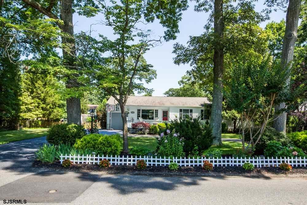 HURRY! THIS METICULOUSLY CARED FOR HOME IS MOVE IN READY ON ONE OF THE MOST PICTURESQUE, TREE LINED