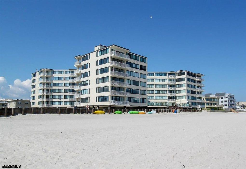 """Beachblock at the """"Point"""" and just a block between beach and bay.  This delightful and spacious one"""