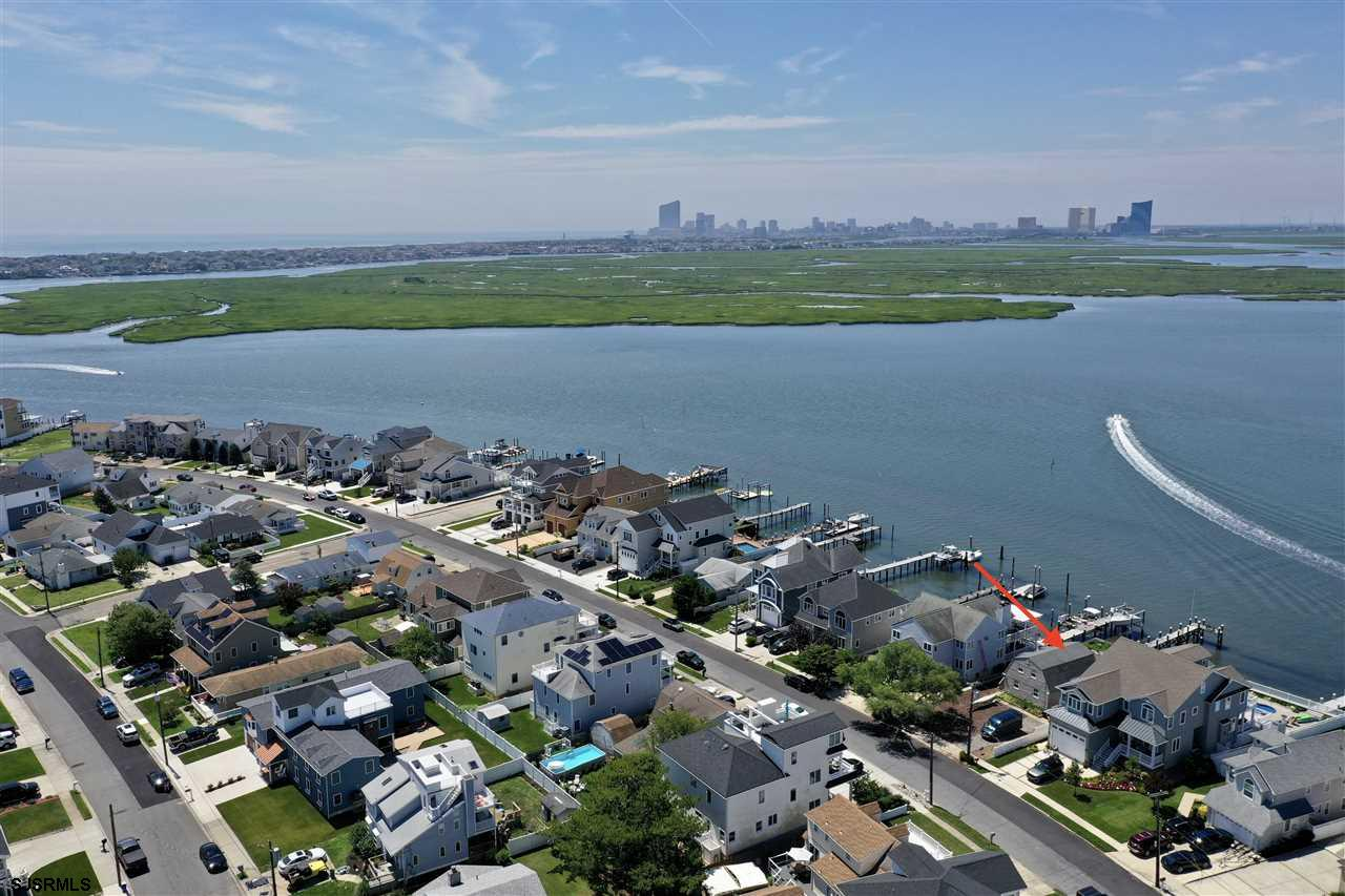 "Located on Brigantine's Gold Coast ""West Shore Drive"" So many possibilities with this 4 bedroom 2 1/"