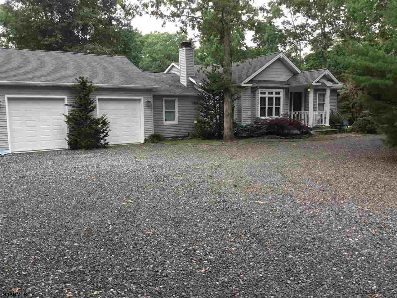 This incredible 3 bedroom, 2.5 bath home is situated on a 4.34 acre wooded lot with a BEAUTIFUL ingr