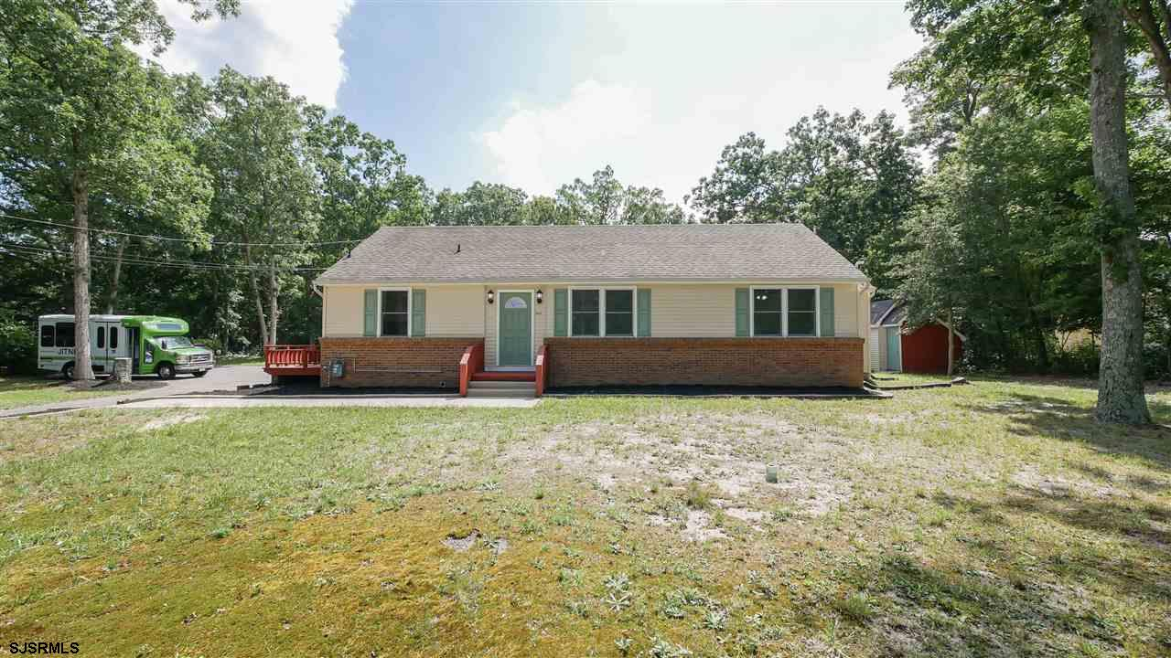 Gracefully nestled on almost three acres of land here is your chance to love where you live! This ra