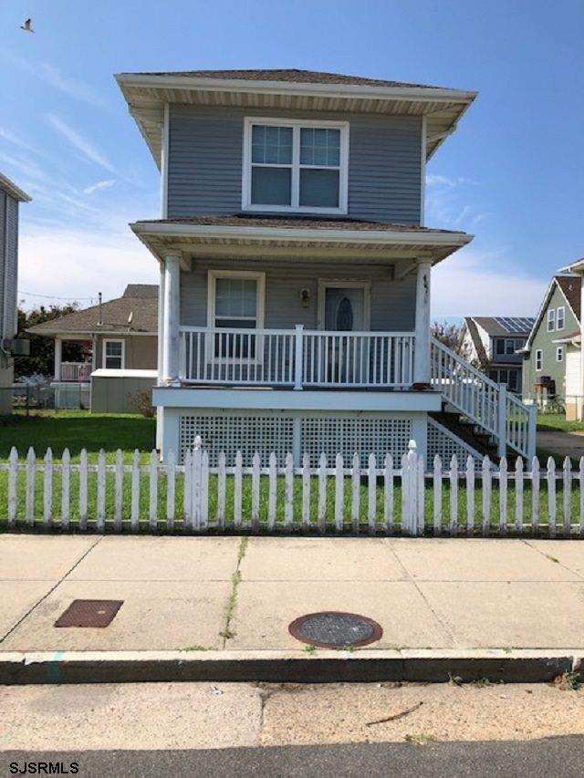 Well-kept 2-story in Marina district. Lovely front porch w ocean breezes.   Property being sold as-i
