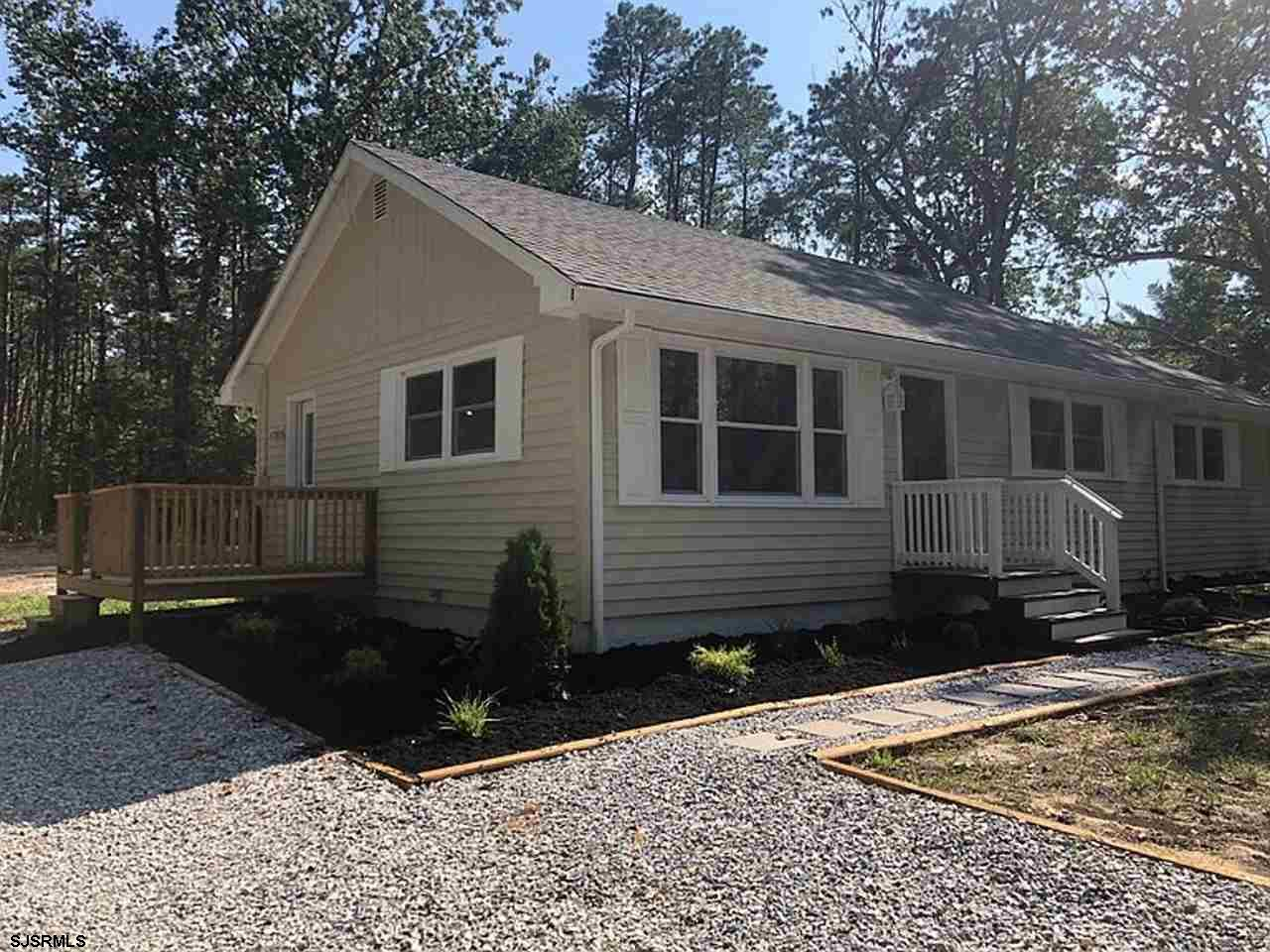 Adorable updated contemporary 3 bedroom 2 Full bath, Ranch style home, private location on 3.63 acre