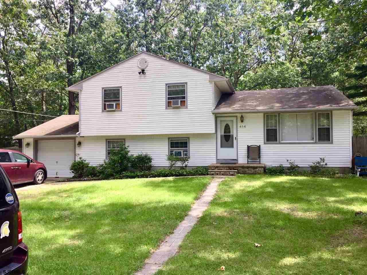 This 4 bedroom Galloway bi-level has plenty of room for everyone with 1834 sf. of living space. Large utility room with extra storage space in converted garage. Wall to wall carpet can be removed to expose original hardwood floors. New water heater and large, fenced in back yard.