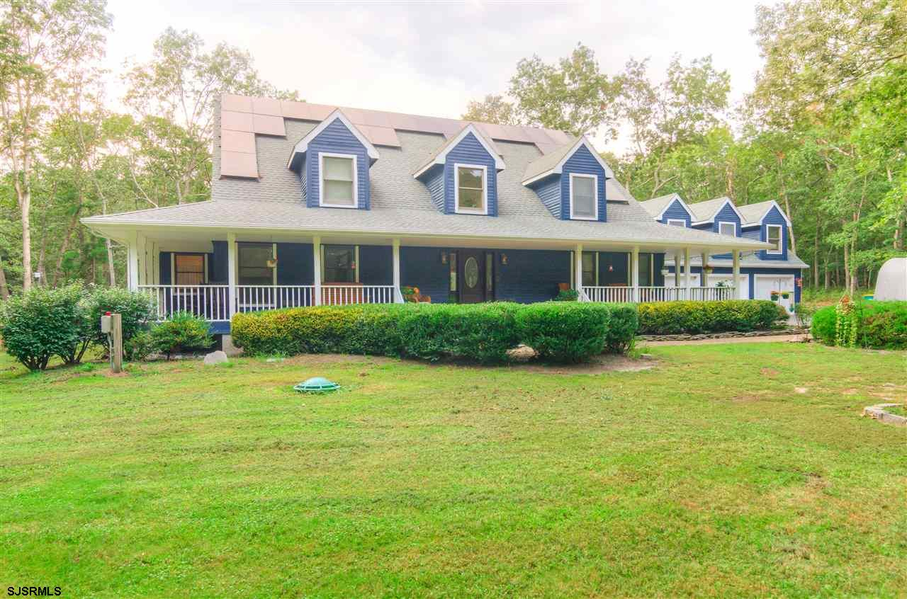 Freshly painted stunning custom built Cape Cod set back on  3 acres of pure peace and tranquility.
