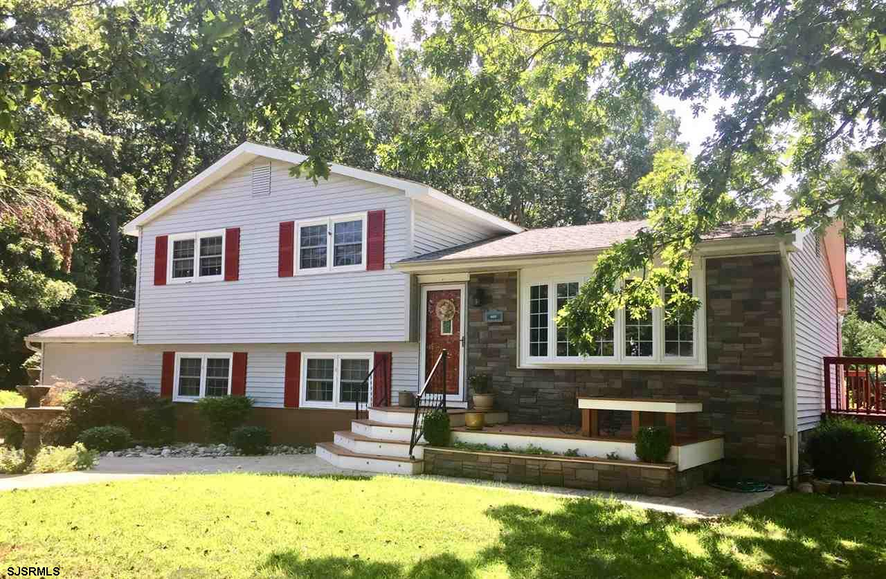 This 4 bedroom Absecon home offers decorative style in a quiet residential setting. Upgraded kitchen features new cabinetry and tile floors with stainless steel appliances. Beautiful new bay window with lifetime warranty. Downstairs bedroom has full bath and private entrance. Stamped concrete walkway and driveway. Composit decking and stone work accent the home's front exterior. Newer 5 year old gas heating system. Water heater replaced 2 years ago, roof replaced in 2008. Fenced in back yard with deck for quiet relaxation. Large shed and attic for storage needs.