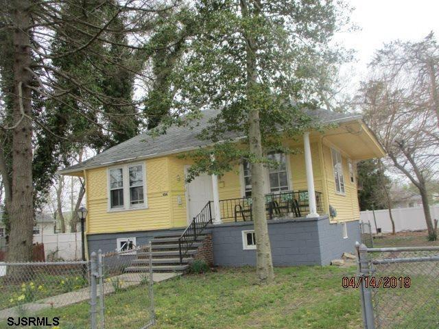 2 BEDROOM ONE LEVEL HOME ON TREE LINED STREET WITH LIVING ROOM, DINING ROOM, AND KITCHEN, FULL BASEM