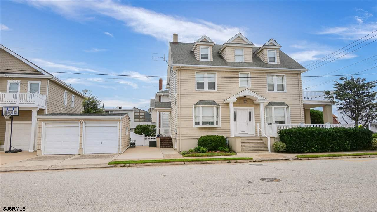 Fabulous and stately well maintained 2.5 story 5 BR, 4 Bath home at the traffic controlled corner of