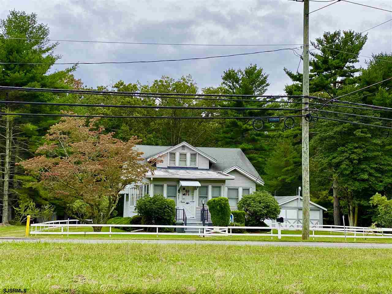 Quaint cottage set on over four acres in Laureldale.  Being sold in as-is condition, no financing. S