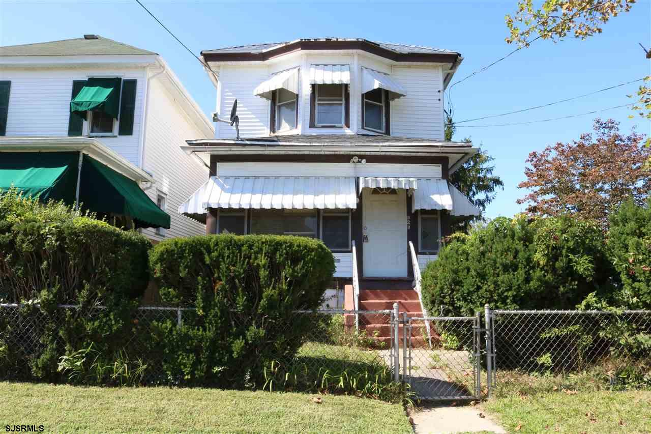 This is a perfect opportunity for an investor to purchase this duplex or an owner occupant can live in the main unit and rent out the other two. Each unit is 2BD's and 1 full bath and there is also a legal cottage behind the duplex which has 2BD's and 1BA rented out for $700.00 a month. Very good long term tenants who want to remain in the cottage. The 1st floor unit consists of a living room, EIK, 2 nice sized BD's and 1 full bath. There is also a basement for add'l storage. The upstairs unit has an EIK, 2 BD's and 1 full bath. One if the BD's can be used as a den/living room. The roof is newer and there is parking in the back of the building where the cottage is located. There is also a 1 car detached garage for addl space. Each until has