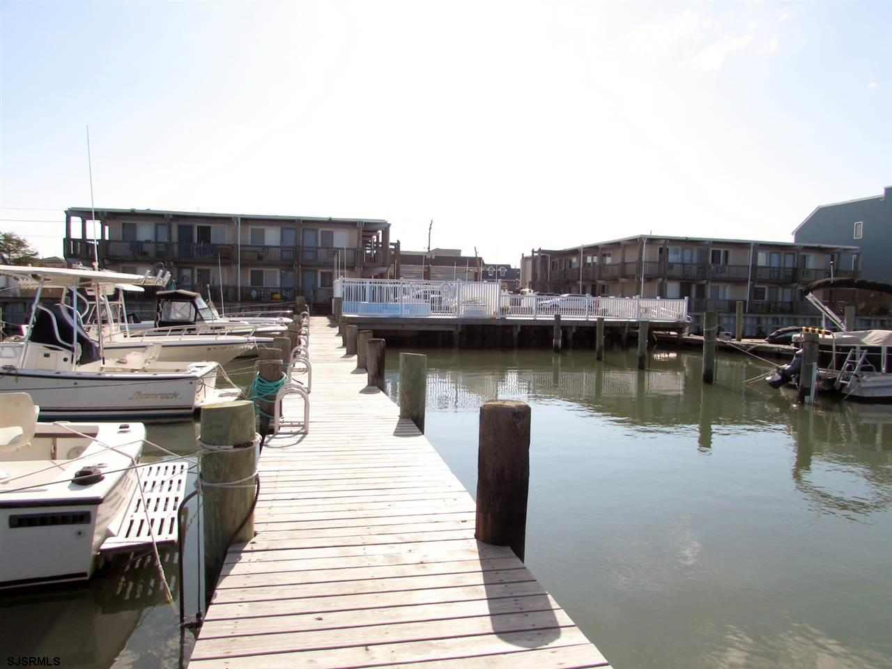 """""""Bay Club"""" one bedroom one bath with boat slip and pool! This 1st floor unit was totally redone abou"""