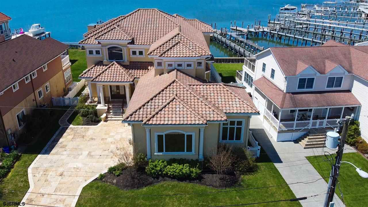 Welcome to your custom-built Mediterranean Bayfront Estate. No expense spared in this builder's own