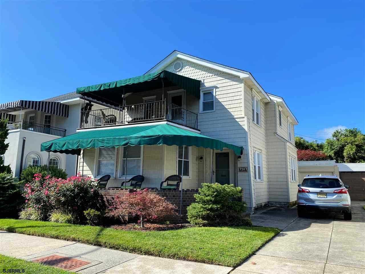 JUST TWO BLOCKS TO THE BEACH!! Large 4 bedroom, 2.5 home featuring hardwood floors throughout, wonde