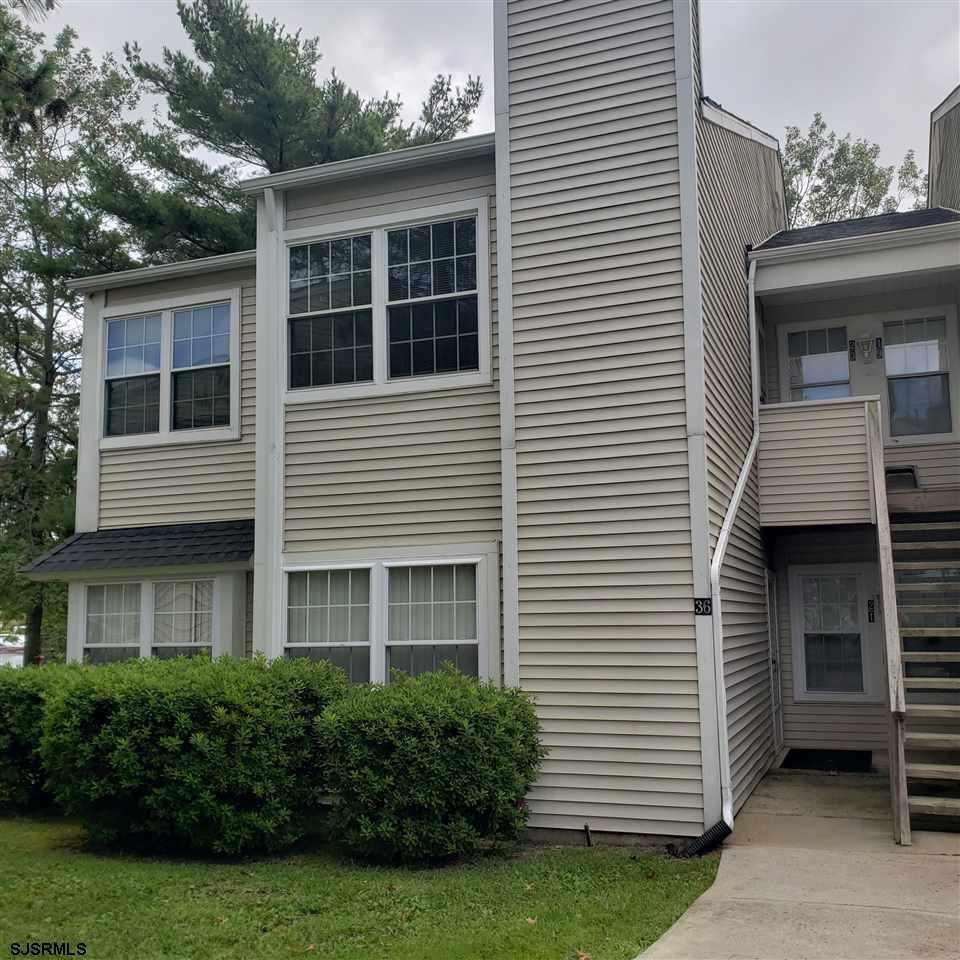 Second floor Fox Chase condo with 1 bedroom, 1 bath and gas heat.  Living room with cathedral ceilings and built in wood burning fireplace.  Kitchen has breakfast nook and all appliances included:  stove, refrigerator, d.w., washer and dryer.  Master bedroom has walk in closet.  Condo is freshly painted , new garbage disposal, and new laminate flooring.  Enjoy all the amenities:  2 pools and Clubhouse, bike paths, tennis courts and walking distance to Smithville Village with shopping and restaurants.  Close to hospitals, Stockton University , GSP, AC Parkway, beaches, casinos.  Call today this one won't last!