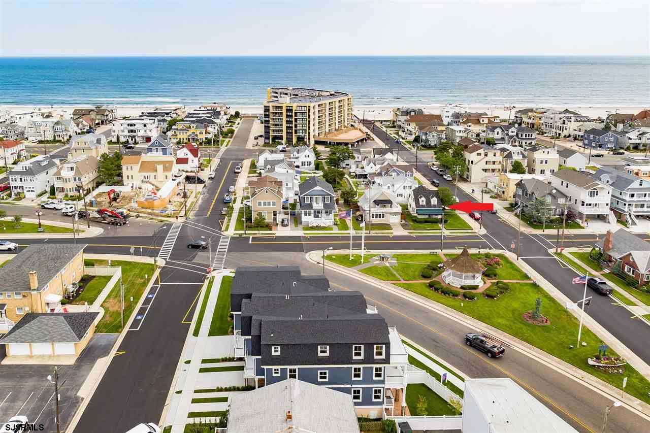 Fabulous Southside location, just steps to the beach! Located on a 40' x 60' corner lot, this classi